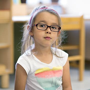 Elementary girl with glasses